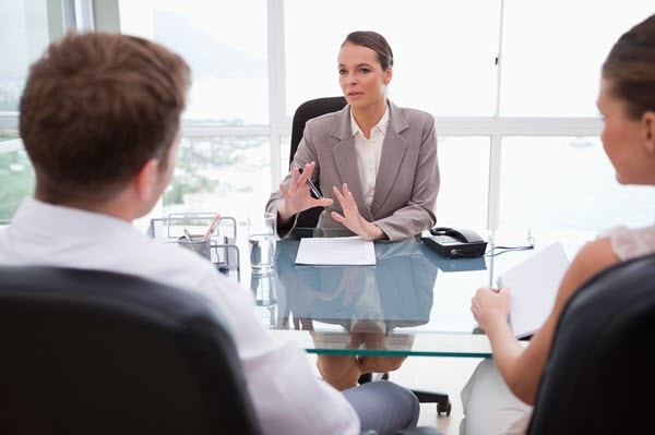 Woman Making First Offer in Negotiation