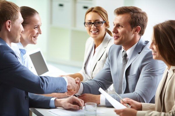 Smiling Employees in a Salary Negotiation